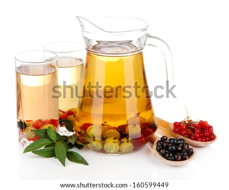 Pitcher and glasses of compote with summer berries isolated on white  - stock photo