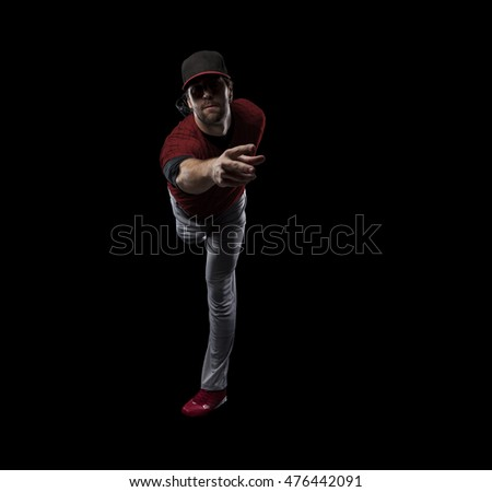 Pitcher Baseball Player with a red uniform on a black background.