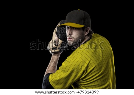Pitcher Baseball Player with a yellow uniform on a black background.