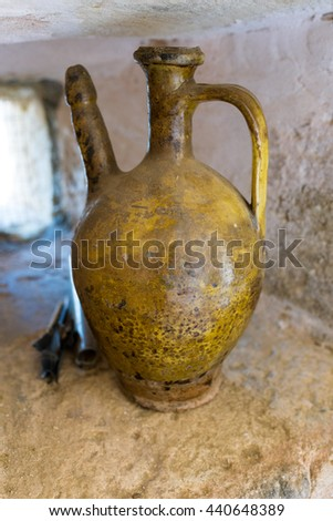 Pitcher in the monastery Odigitrias. Monastiri Odigitrias, is an old cloister from the 14 century in south Crete. The terracotta jug is to see in an exhibition about the monastery and there monks - stock photo