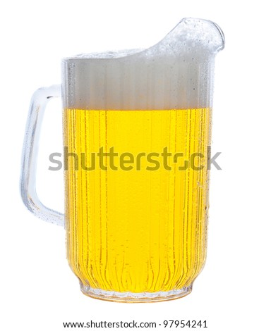 Pitcher of beer in vertical format over white. - stock photo