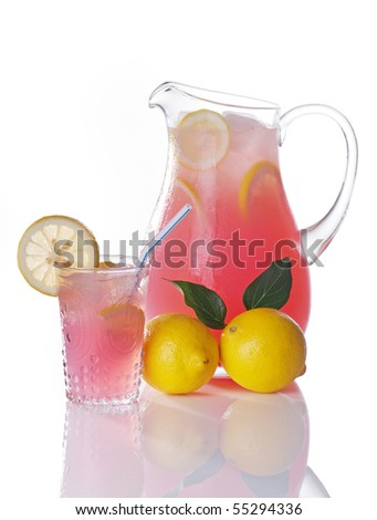 Pitcher of pink lemonade with glass and whole lemons - stock photo