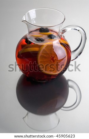Pitcher of Red Sangria with aranges and blackberries on grey background close up - stock photo