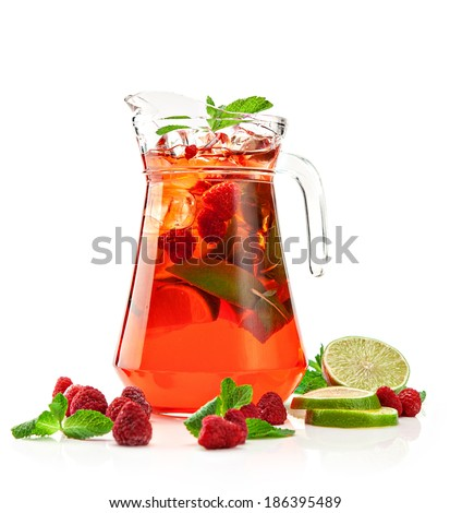 pitcher with a refreshing raspberry mojito with fresh mint and strawberries on a white background  - stock photo