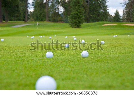 Pitching and chipping areas over a sand bunker. Shallow depth of field. Focus on the ball in the center. - stock photo