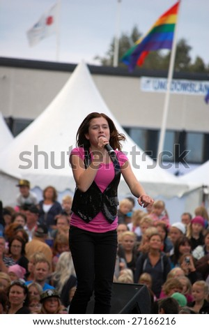 PITEA, SWEDEN - AUGUST 5: Singer Amy Diamond performs at Nolia Massan on 5 August, 2008 in Pitea, Sweden. Diamond is a Swedish/English pop singer released her debut single when she was 12 years old. - stock photo