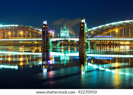 Piter the first bridge in winter night (Saint-Petersburg Russia, Neva River) - stock photo