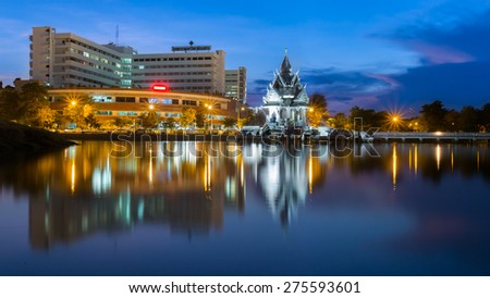 Pitsanulok-Thailand - May 6 2015: Building reflection of Naresuan University Hospital at Twilight time. This hospital locate in Pitsanulok, Thailand.