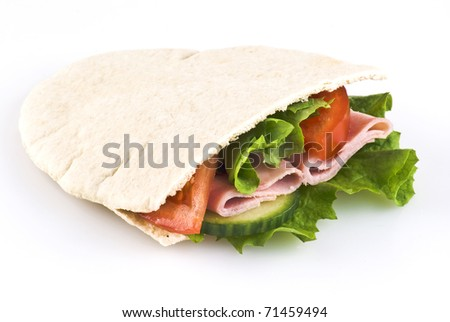 Pitta bread pocket filled with salad tomato cucumber and ham - stock photo
