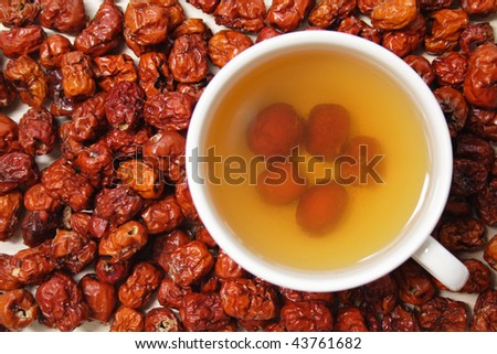 Pitted Chinese jujubes with a cup of jujube tea, taken from top angle - stock photo