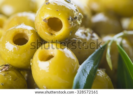 Pitted green olives with virgin extra olive oil and leaves - stock photo