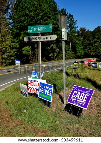 Pittsboro, NC - October 23, 2016:  A jumble of 2016 campaign advertising signs for both local and national candidates at the intersection of two rural roads
