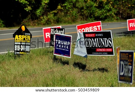 Pittsboro, NC - October 23, 2016:  2016 Campaign  political advertising signs for both local and national candidates at the intersection of two rural roads