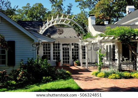Pittsboro, North Carolina - October 28, 2016:  Gardens and trellis terrace at the Five star luxury Fearrington House Hotel at Fearrington Village