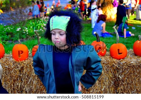 Pittsboro, North Carolina - October 30, 2016:  Little boy dressed as Frankenstein at the annual Fearrington Village Halloween event