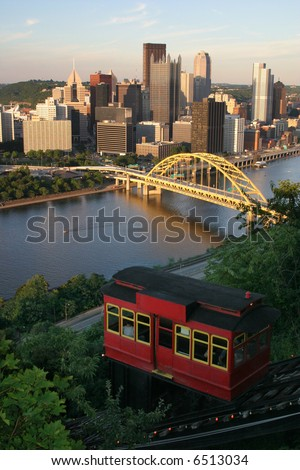 Pittsburgh Incline: A view of the city and historic incline car in use from atop the Duquesne Incline in Pittsburgh, PA. - stock photo