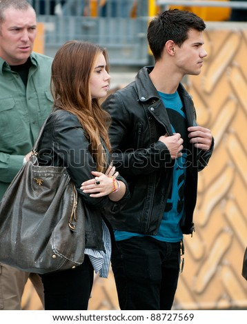 PITTSBURGH, PA - SEPTEMBER 12:  Actor Taylor Lautner and Abduction co-star Lily Collins visit the sidelines prior to the Pittsburgh Steelers / Atlanta Falcons football game at Heinz Field in Pittsburgh, PA on Sept. 12, 2010. - stock photo