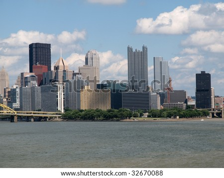 Pittsburgh Pennsylvania river view and skyline on a bright clear day. - stock photo