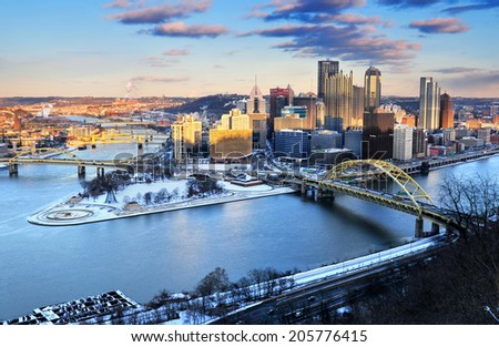 PITTSBURGH, PENNSYLVANIA, USA - JAN. 2014: The city skyline view of Pittsburgh, the second largest city of Pennsylvania in winter sunset.