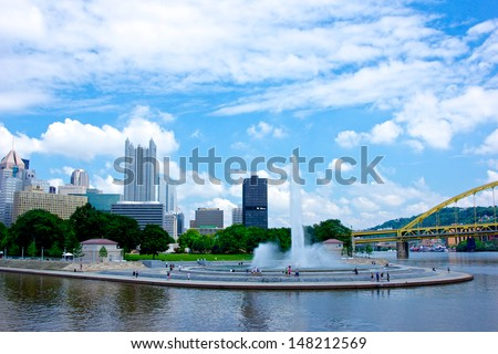 Pittsburgh's Point State Park fountain with the skyline rising up behind it. - stock photo