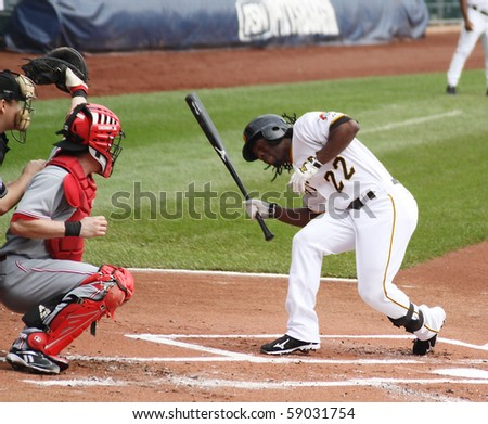 PITTSBURGH - SEPTEMBER 24 : Andrew McCutcheon of the Pittsburgh Pirates ducks on an inside pitch against the Cincinnati Reds on September 24, 2009 in Pittsburgh, PA. - stock photo