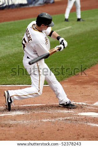 PITTSBURGH - SEPTEMBER 24 : Andy LaRoche of the Pittsburgh Pirates swings at a pitch against Cincinnati Reds on September 24, 2009 in Pittsburgh, PA.