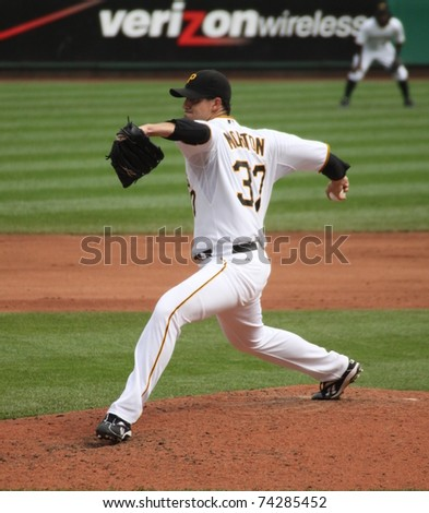 PITTSBURGH - SEPTEMBER 24 :Charlie Morton of the Pittsburgh Pirates fires a pitch against the Cincinnati Reds on September 24, 2009 in Pittsburgh, PA. - stock photo