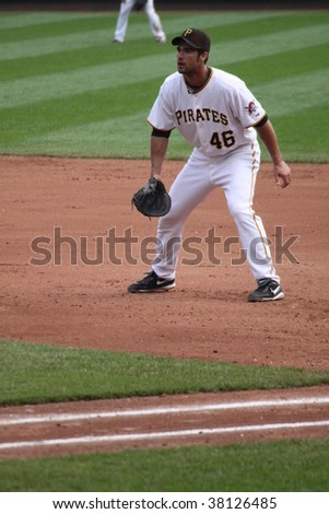 PITTSBURGH - SEPTEMBER 24 : Garrett Jones of Pittsburgh Pirates playing first base against the Reds on September 24, 2009 in Pittsburgh, PA.