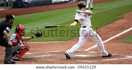 PITTSBURGH - SEPTEMBER 24 : Neil Walker of the Pittsburgh Pirates swings at a pitch against Cincinnati Reds on September 24, 2009 in Pittsburgh, PA. - stock photo