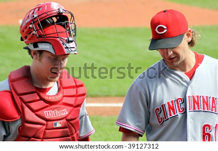 PITTSBURGH - SEPTEMBER 24 : Ryan Hanigan and Bronson Arroyo of the Cincinnati Reds discuss strategy between innings against the Pittsburgh Pirates on September 24, 2009 in Pittsburgh, PA. - stock photo