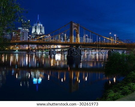 Pittsburgh skyline and the Ohio River at night. - stock photo
