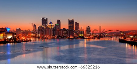 Pittsburgh Skyline at Night:  A view of Pittsburgh at night overlooking Pittsburgh's Three Rivers (Allegheny, Monongahela, and Ohio), the Fort Pitt and Fort Duquesne Bridge, and Point State Park. - stock photo