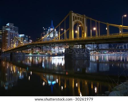 Pittsburgh skyline, Ohio River and bridges at night. - stock photo