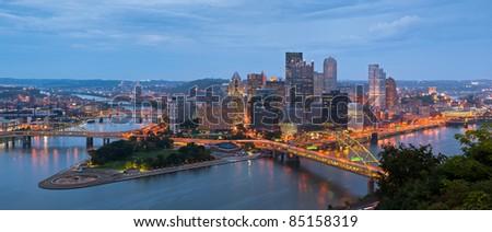 Pittsburgh skyline panorama. Panoramic image of Pittsburgh skyline at twilight. - stock photo