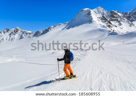 PITZTAL GLACIER, AUSTRIA - MAR 29: Woman skier on slope in the mountains of Pitztal winter resort on 29th March 2014, Austrian Alps