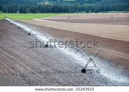 Pivot irrigation system watering a farm field