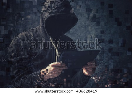 Pixelated unrecognizable faceless hooded cyber criminal man using digital tablet to access internet deep web page, p2p and piracy concept. - stock photo