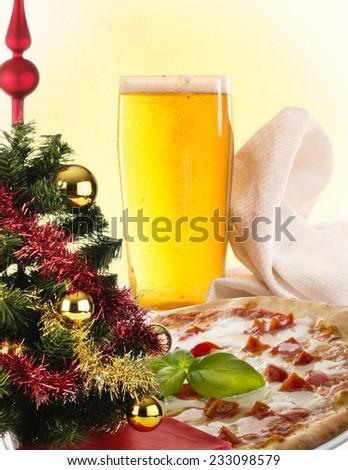 pizza and christmas tree - stock photo
