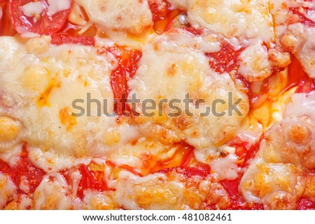 pizza and ingredients on a table