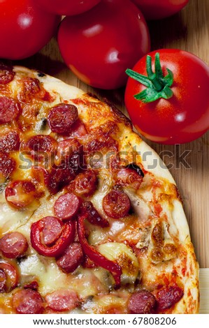 Pizza and red tomato