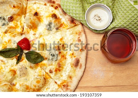 Pizza and wine on wooden table - stock photo