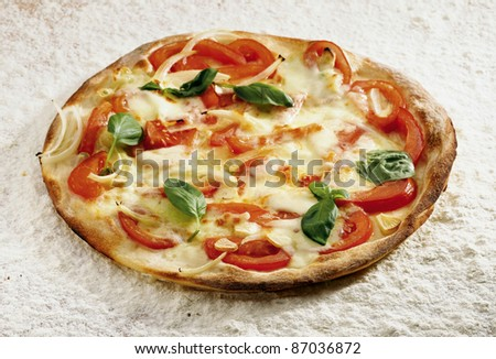 Pizza casarecce on a flour background - stock photo