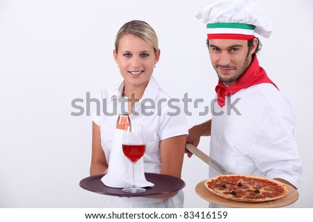 Pizza chef and waitress - stock photo