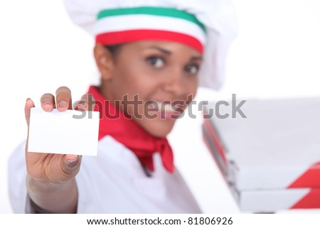 Pizza chef holding up a blank business card - stock photo