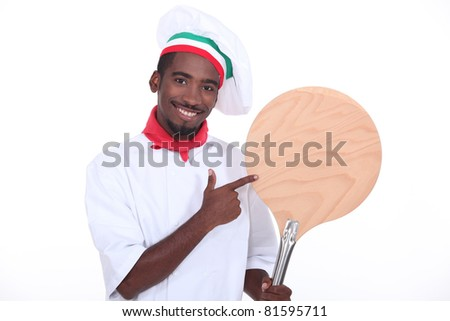 Pizza chef showing his pizza loading peel - stock photo