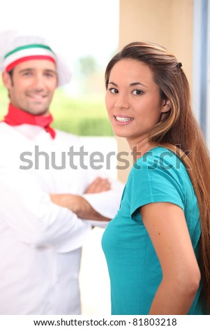 Pizza chef stood at customers door - stock photo