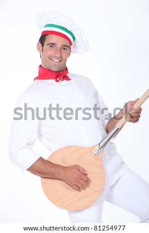 pizza cook playing guitar with a spade - stock photo
