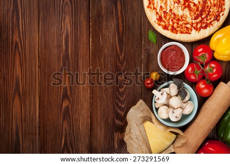 Pizza cooking ingredients. Dough, vegetables and spices. Top view with copy space - stock photo