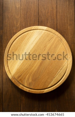 pizza cutting board at table background - stock photo