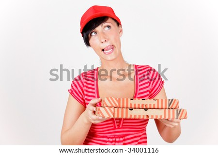 Pizza delivering woman making tasty expression with tongue licking over lips - stock photo